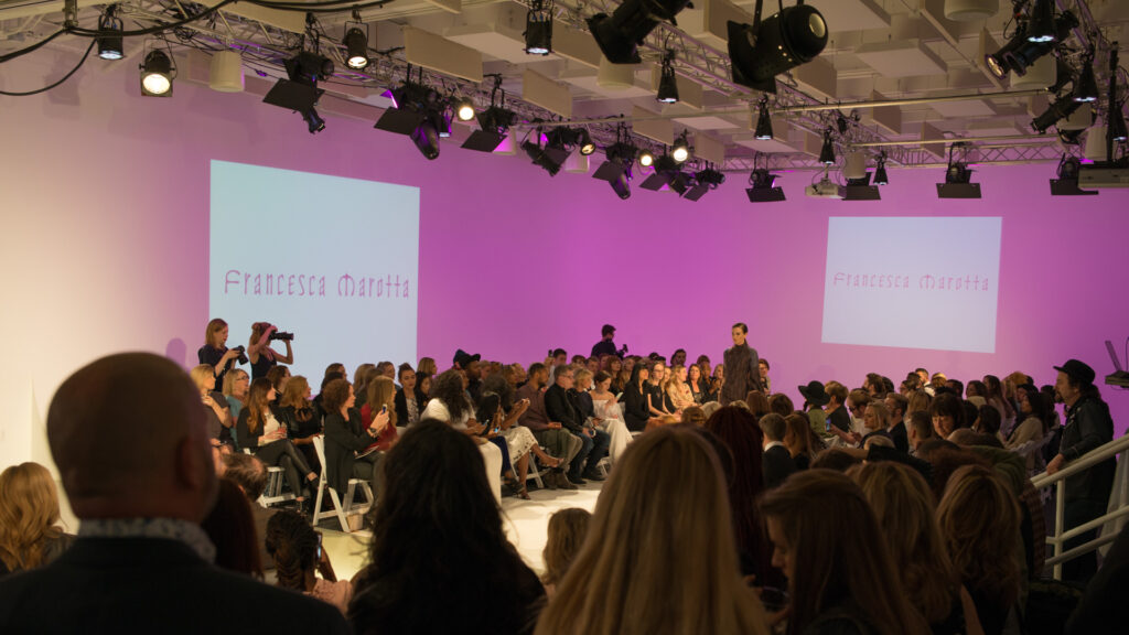 a fashion runway event in a large, open studio space