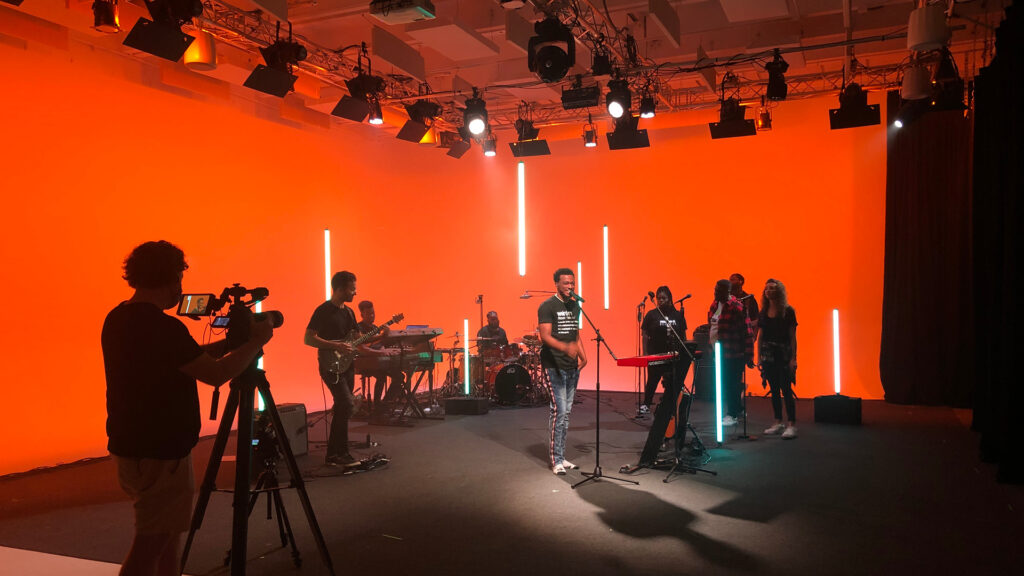 A music video shoot in an elaborate professional studio space